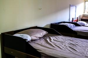 A bed or beds in a room at Hostel Villa Brasilia