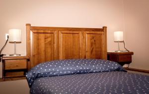 Cama o camas de una habitación en Apartamentos rurales San Esteban de los buitres