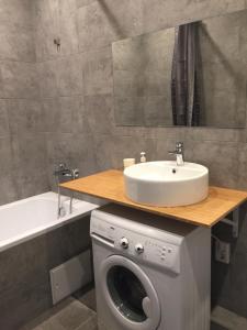A bathroom at Happy Apartment on Zelinsky Street 5