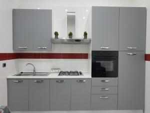 A kitchen or kitchenette at Mary's Sweet Home Napoli