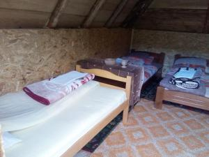A bed or beds in a room at Eco Village Goles
