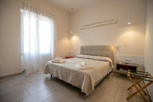 A bed or beds in a room at Residenza Eleonora