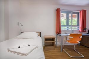 Letto o letti in una camera di LSE High Holborn