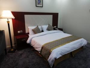 Cama ou camas em um quarto em The Distinctive Palace