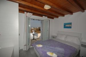 Ένα ή περισσότερα κρεβάτια σε δωμάτιο στο Lino Apartments