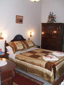 Uma cama ou camas num quarto em Residencial Dandy