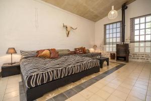 Ein Bett oder Betten in einem Zimmer der Unterkunft La Vega Studios