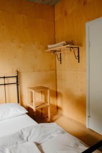 A bed or beds in a room at Hafaldan HI Hostel - Harbour Building