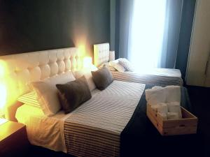 A bed or beds in a room at Ottomood Ala Ovest Catania Centro