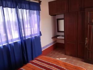Cama o camas de una habitación en El Maná de San Francisco