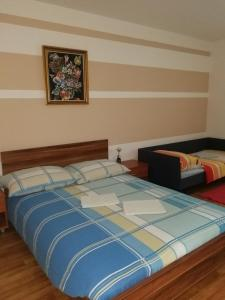 A bed or beds in a room at Brne Rooms