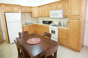 A kitchen or kitchenette at Simpson Bay Suites