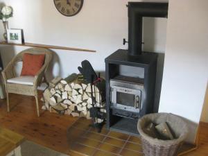 Ein Sitzbereich in der Unterkunft Kallmuth Cottage