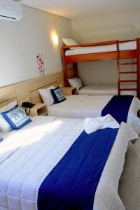Cama o camas de una habitación en Mandala Hotel