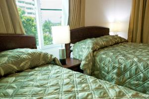 A bed or beds in a room at Simpson Bay Suites