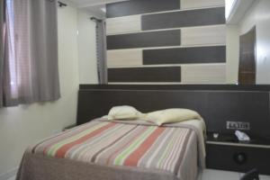 A bed or beds in a room at Hotel Calstar