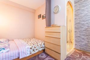 Кровать или кровати в номере Apartments at Aprelskaya 5