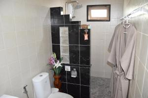 Een badkamer bij Homestay Chiangrai