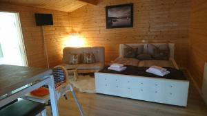 Ein Sitzbereich in der Unterkunft Relax-Huetten-Gröden