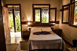 A bed or beds in a room at Pousada Morro dos Navegantes