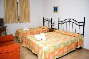 Een bed of bedden in een kamer bij Villa la Dehesa