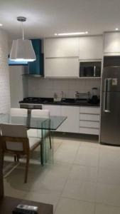 A kitchen or kitchenette at Flat Green Ville Prime
