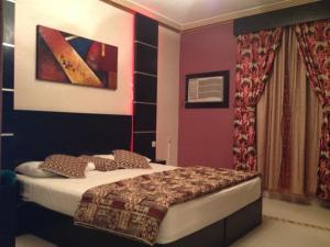 Cama ou camas em um quarto em Najmat Manami AlQuds