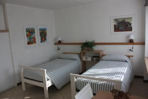 A bed or beds in a room at B&B Brixius
