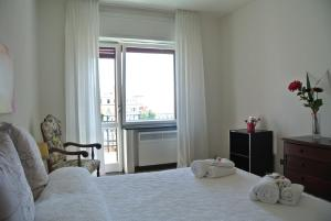 A bed or beds in a room at Casa di Linda