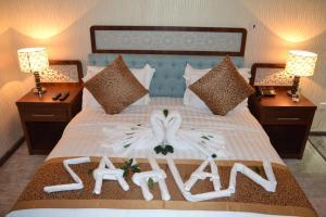 Cama ou camas em um quarto em Sahlan House