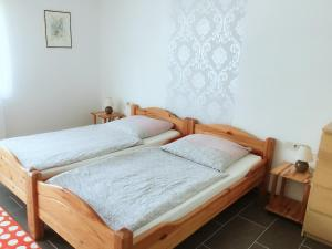 A bed or beds in a room at Eifelhof Weina