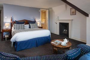 A bed or beds in a room at Chirnside Hall Hotel