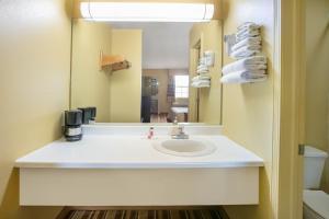 A bathroom at Super 8 by Wyndham Big Cabin/Vinita Area