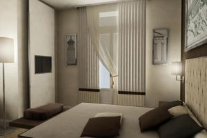 A bed or beds in a room at Menelaion Hotel