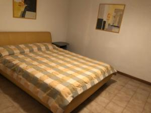 A bed or beds in a room at Residence Corte del Sole Aprilia Marittima Costa Nord Adriatica