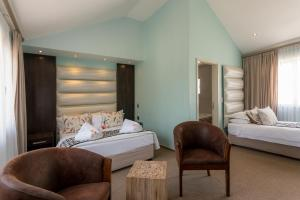 A bed or beds in a room at Swakopmund Sands