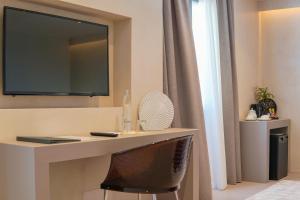 TV o dispositivi per l'intrattenimento presso Villa Fiorita Boutique Hotel