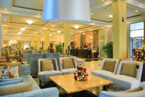 A restaurant or other place to eat at Swiss Inn Nexus Hotel