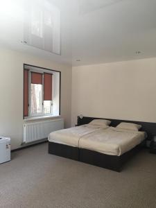 Кровать или кровати в номере Metelitsa