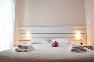 Ένα ή περισσότερα κρεβάτια σε δωμάτιο στο Akro Rooms
