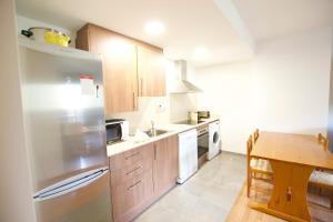 A kitchen or kitchenette at Apartamento Puigmal