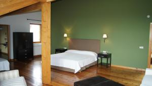 A bed or beds in a room at Gran Hotel Pandorado