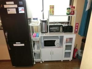 A kitchen or kitchenette at Mt Fuji Hostel Michael's