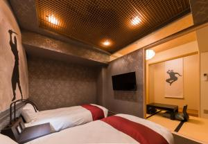 A bed or beds in a room at SARASA HOTEL Namba