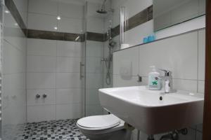 Ein Badezimmer in der Unterkunft Hotel Mykonos