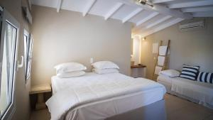 A bed or beds in a room at Parthenis Hotel & Suites