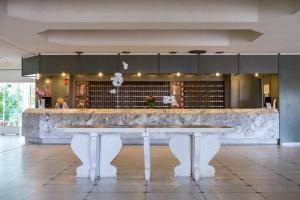 The lobby or reception area at GHotels Pallini Beach