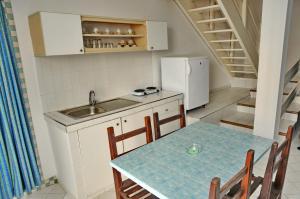 A kitchen or kitchenette at Appart-Hôtel Tagadirt