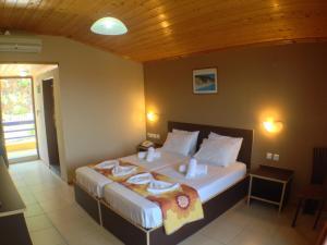 Ένα ή περισσότερα κρεβάτια σε δωμάτιο στο Politia Hotel