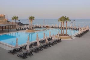 A view of the pool at The Westin Dragonara Resort, Malta or nearby